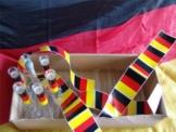 Party Set aus 100 Stck Reagenzgläser (mit Rand) 160x16 inkl. Acrylständer, & Aufkleber in schwarz rot gelb -